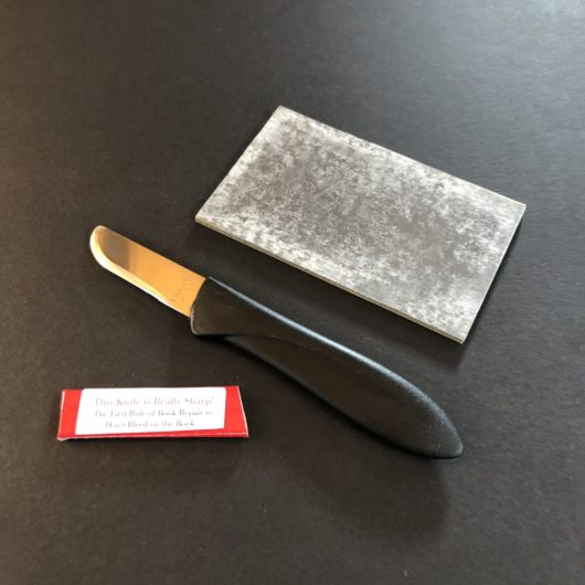 Right handed book repair knife