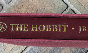 cut on a book spine before restoration